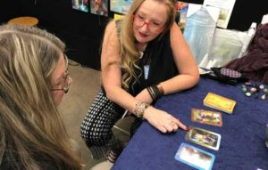 Reading Transformation Oracle Cards at a Show